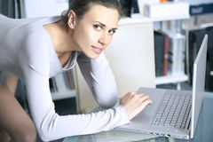 Young women works on a laptop Stock Image