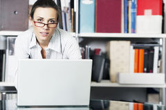 Young women works on a laptop Stock Photos