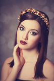 Young women with wreath. Royalty Free Stock Photo