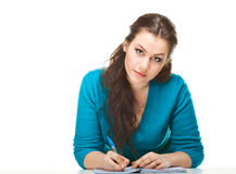 Young women writing in the exercise book Royalty Free Stock Photo