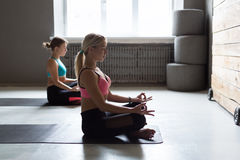 Young women in yoga class, relax meditation pose Royalty Free Stock Photos