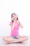 Young womn sit listen music Stock Photography