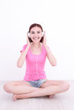 Young womn sit listen music Stock Image