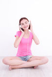 Young womn sit listen music Royalty Free Stock Image