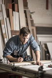 Young woodworker working in carpentry Stock Images