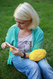 Young wooman with needlework Stock Photography
