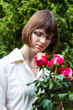 Young wooman with roses Stock Images