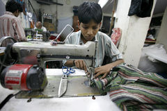 Young worker. Young textile worker in factory in delhi, india Stock Photography