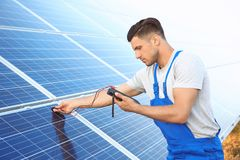 Young worker checking installation of solar panels Stock Photography