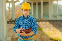 A young worker with clipboard Stock Images