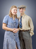Young worker couples in vintage clothing Royalty Free Stock Photos