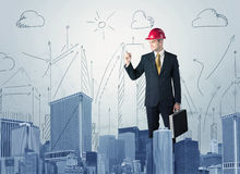 Young worker drawing a city sight Stock Image