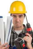 Young worker with a drill is angry Royalty Free Stock Images