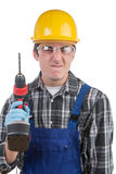 Young worker with a drill is angry Stock Photos