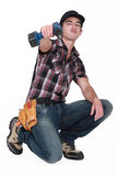 Young worker with drill Stock Photography