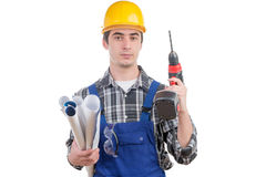 Young worker with a drill Royalty Free Stock Photos