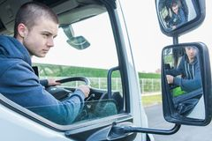 Young worker driving truck. Young worker driving a truck Royalty Free Stock Photos