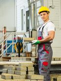 Young worker on a factory Stock Image