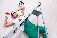 The young worker falling from the ladder royalty free stock photos