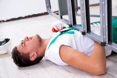 The young worker falling from the ladder stock image