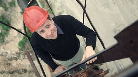 Young worker going up the stairs stock footage