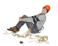 A young worker in grey uniform tied up with rope on white isolated background. Stock Images