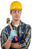 Young worker with a hammer Stock Image