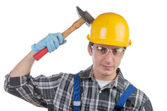 Young worker with a hammer Stock Photos