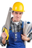 Young worker with a handsaw is angry Stock Image