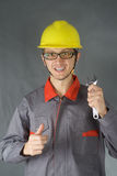 Young worker in helmet with wrench Royalty Free Stock Photos