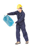 Young worker hold Hod or clam-shell shaped basket Royalty Free Stock Photo