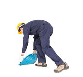Young worker hold Hod or clam-shell shaped basket Royalty Free Stock Photos