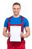 Young worker holding blank clipboard against white. Stock Photos