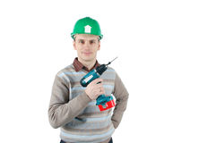 Young worker holds a drill in his hand Stock Image