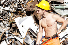 Young worker in a junkyard Royalty Free Stock Images