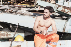 Young worker in a junkyard Stock Image