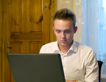 Young worker with laptop. Browsing internet sites stock photos