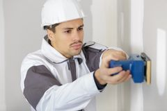 Young worker making repair in room. Young Stock Photos