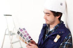Young worker man choosing color of his flat Stock Photos