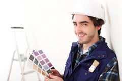 Young worker man choosing color of his flat Royalty Free Stock Photography
