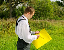 Young worker with notes. Stock Photos