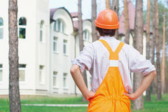 Young Worker Outdoors Looking At The Building Stock Photos