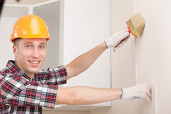 Young worker with paint brush Royalty Free Stock Images