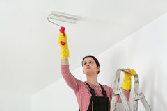Young worker paint ceiling in a room Stock Images