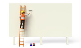 Young Worker painting a wall Royalty Free Stock Photography
