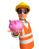 Young worker with piggy bank Royalty Free Stock Photography