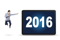 Young worker pointing at numbers 2016 Stock Images