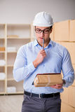 The young worker in the postal office dealing with parcels Stock Photos