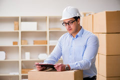 The young worker in the postal office dealing with parcels Stock Image
