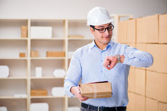 The young worker in the postal office dealing with parcels Royalty Free Stock Images